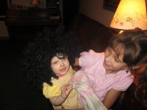 "Tessie put a ""wig"" on Sofia at the Philbricks.  SO funny!"