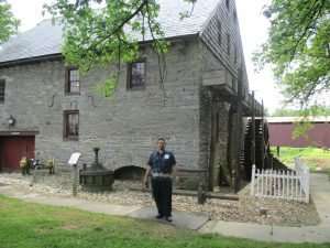 David standing in front of the building/mill.