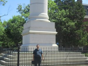 David standing in front of a statue honoring the veterans of the Civil War.