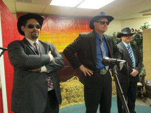 "David & the Pastor and a couple of other men, played the ""policing"" cowboys in this skit - telling Timothy he MUST come to VBS!  It was SO funny!"