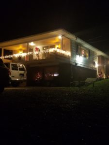 Our home outside during Christmas time!!  COZY